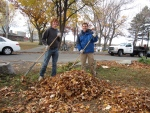 Our State Rep. Jay Livingstone hard at work, raking with Will!