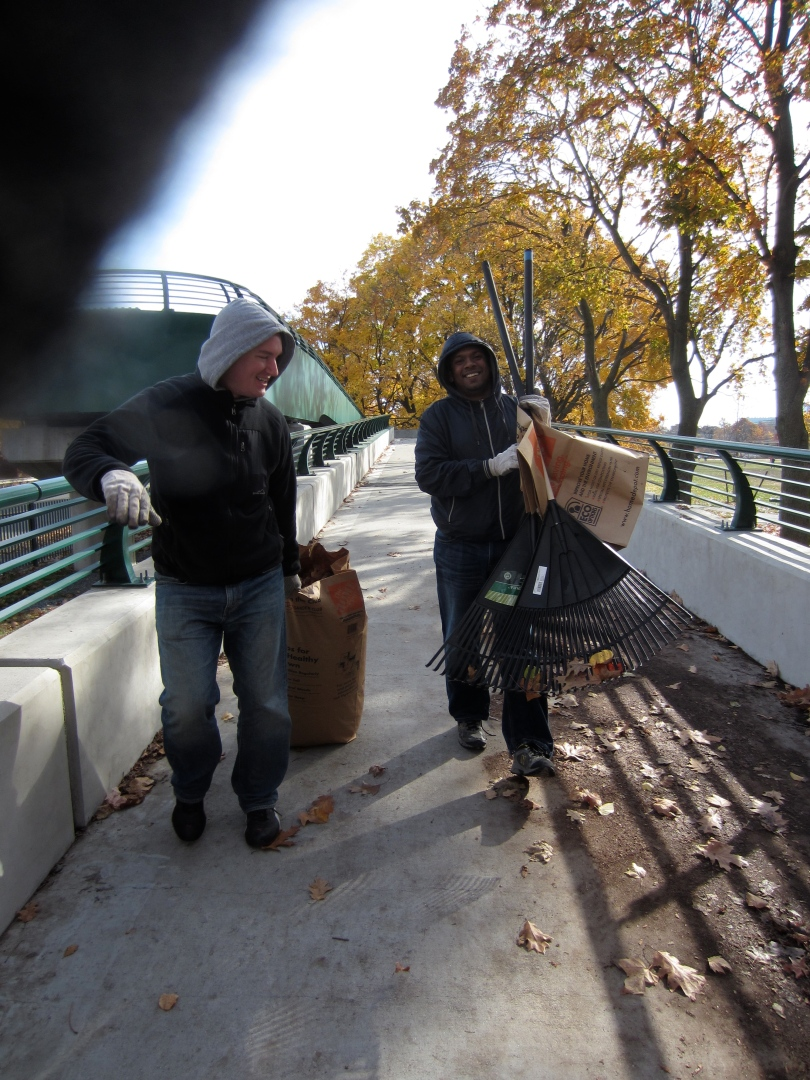Sweeping and removing graffiti from the bridge.