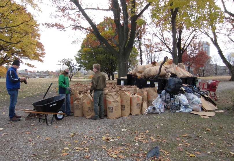 The Charles River Conservancy's Danielle Stehlik and volunteer Sam counting the bags.